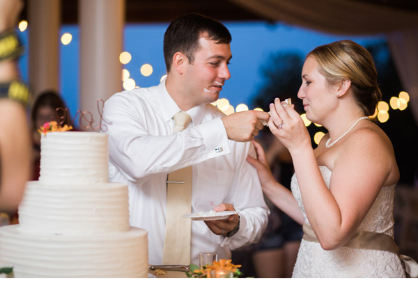 bride groom feeding cake